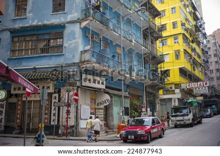 HONG KONG, CHINA - SEP 7: Hong Kong old houses are painted to be blue and other colors on September 7,2014 in Hong Kong, China.  - stock photo