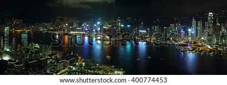 HONG KONG, CHINA - SEPTEMBER 23, 2015: Skyline of the skyscrapers illuminated at sunset from 100 floor of ICC building in Hong Kong. - stock photo