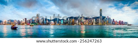 Hong Kong, China skyline panorama from across Victoria Harbor. - stock photo