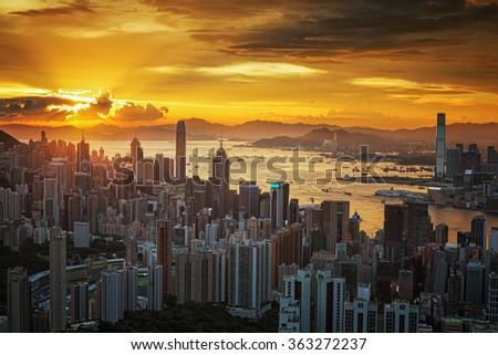 Hong Kong city with sunset - stock photo