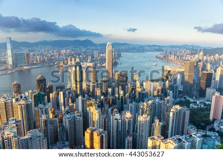Hong Kong city with sunset - stock photo