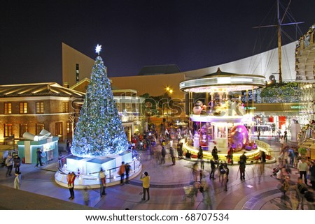 HONG KONG - DECEMBER 25: Crowds gather at 1881 Heritage or former Marine Police Headquarters market square for Christmas Celebrations on December 25, 2010 in Hong Kong. - stock photo