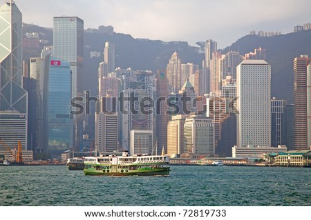 HONG KONG - DECEMBER 3: Ferry cruising Victoria harbor on December 3, 2010 in Hong Kong, China. Hong Kong ferry is in operation for over 120 years and it is one main tourist attractions of the city. - stock photo