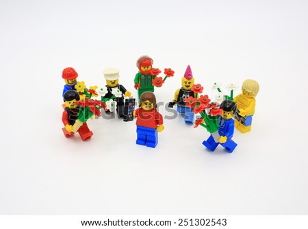 HONG KONG, FEB 14: group of lego mini characters from different genation which are isolated on white in hong kong on 14 february 2014. Lego minifigure are the successful line in Lego products - stock photo