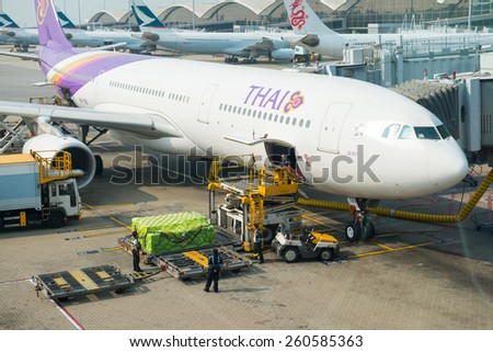 HONG KONG, FEB 07, 2015: Thailand Airlines Boeing flight in Hong Kong International Airport. About 90 airlines operate flights from HKIA to over 150 cities across the globe. - stock photo
