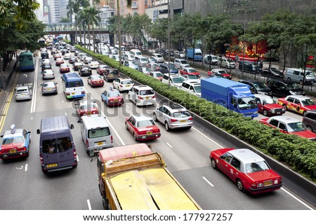 HONG KONG - FEB 9, Traffic jam at Wan Chai, Hong Kong on 9 February, 2014. It is one of the busiest district in Hong Kong. Hong Kong's above-ground transport is running into major challenges.  - stock photo