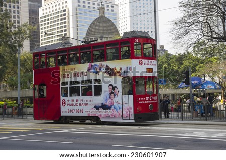 HONG KONG - FEBRUARY 23: Double-decker tram on February 23, 2013 in Hong Kong. Hong Kong tram is the only system in the world run with double deckers, major tourist attraction in Hong Kong - stock photo