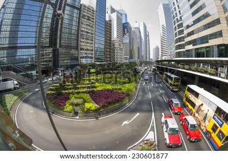 HONG KONG - FEBRUARY 23: Fisheye view on skyscrapers on February 23, 2013 in Hong Kong. Hong Kong is an international financial centre that has 112 buildings that stand taller than 180 metres - stock photo