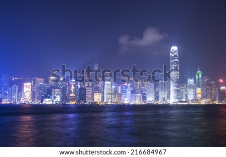 HONG KONG - FEBRUARY 23:Victoria Harbor in Hong Kong on February 23, 2013 in Hong Kong. A Symphony of Lights is the spectacular light and sound show at Victoria Harbour - stock photo