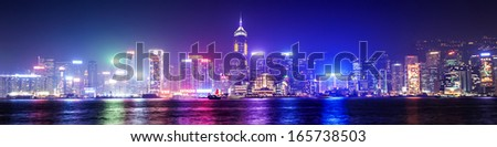 HONG KONG - FEBRUARY 21: Victoria Harbor in Hong Kong on February, 21, 2013. The Victoria Harbour is world-famous for its stunning panoramic night view and skyline. - stock photo