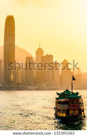 Hong Kong Harbour at sunset. - stock photo