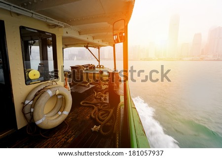 Hong Kong harbour at sunset, view from ferry - stock photo