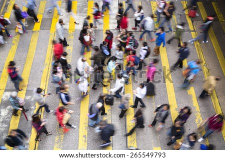 Hong Kong, Hong Kong SAR -November 13, 2014: Crowded pedestrian crossing during rush hour in Hong Kong. - stock photo