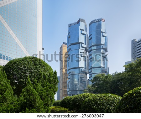 Hong Kong, Hong Kong SAR -November 17, 2014:  The Lippo Centre is a twin-tower skyscraper complex completed in 1988 at 89 Queensway, in Admiralty in Hong Kong.  - stock photo
