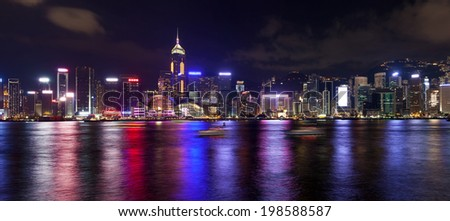 Hong Kong Island Central City Skyline Along Victoria Harbor at Night with Colorful Reflection Panorama - stock photo