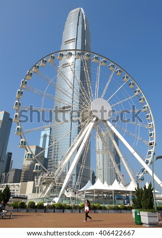 HONG KONG - JAN 17, 2016: Ferris wheel and skyscrapers in Central waterfront on Jan 17, 2015 in Hong Kong, China. It is a popular destination on Hong Kong island. - stock photo