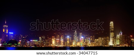 HONG KONG - JULY 16: Night view of Hong Kong July 16, 2009 in Hong Kong. Hong Kong shares rose 0.6 percent in a third session of gains, with investors cheered by signs of a turnaround in key economies - stock photo