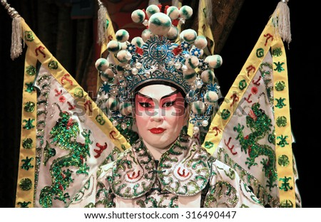 HONG KONG - JUNE 27, 2014 : Cantonese opera dummy with traditional makeup on June 27, 2014 in Hong Kong. Originating in southern China, Cantonese opera is a popular theatrical art in Hong Kong. - stock photo