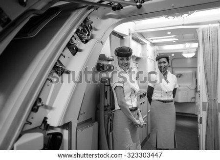HONG KONG - JUNE 18, 2015: Emirates crew member meet passengers on A380 second floor. Emirates is one of two flag carriers of the United Arab Emirates along with Etihad Airways and is based in Dubai. - stock photo