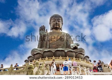 HONG KONG - JUNE 14, 2015: Tian Tan Buddha aka the Big Buddha is a large bronze statue of a Sakyamuni Buddha and located at Ngong Ping Lantau Island in Hong Kong. - stock photo
