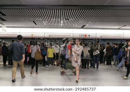 HONG KONG - MAR 30 : Tourists and locals walking access to the subway on March 30,2015 at MTR hong kong - stock photo