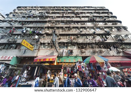 HONG KONG - MARCH 18 : Crowded residential in old district on March 18, 2013 in Hong Kong. With land mass of 1104 km and 7 million people, Hong Kong is one of most densely populated areas in the world - stock photo