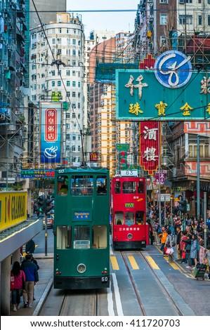 HONG KONG - March, 14, 2009: Double-decker tram in Hong Kong street - stock photo