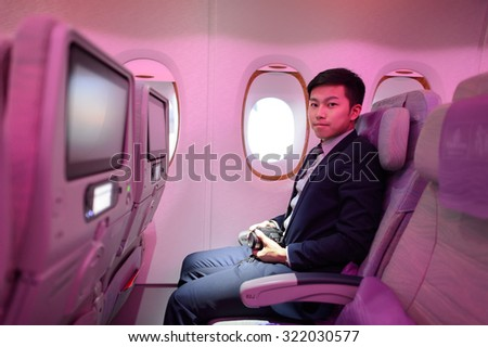 HONG KONG - MARCH 09, 2015: Emirates Airbus A380 economy class passenger. Emirates handles major part of passenger traffic and aircraft movements at the airport. - stock photo