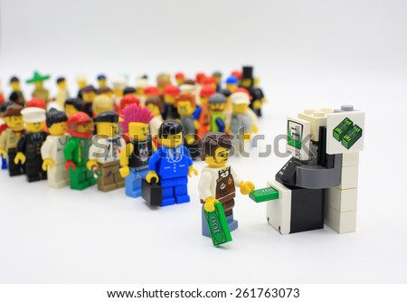 HONG KONG,MARCH 1: lego mini characters waiting ATM which are isolated on white in hong kong on 1 March 2015. Lego minifigure are the successful line in Lego products toy - stock photo