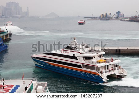 HONG KONG - MARCH 15: Passenger Ferry to China leaves Kowloon terminal, Hong Kong on March 15th, 2013  - stock photo