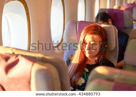 HONG KONG - MARCH 08, 2016: woman in Emirates Airbus A380. The Airbus A380 is a double-deck, wide-body, four-engine jet airliner manufactured by Airbus. It is the world's largest passenger airliner. - stock photo