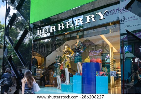 HONG KONG - MAY 25, 2015: Burberry store in Hong Kong. Burberry is a British luxury fashion house founded in 1856 by 21 year old Thomas Burberry. - stock photo
