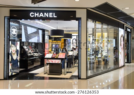 HONG KONG - MAY 05, 2015: Chanel cosmetics boutique interior. Cosmetics are the most accessible Chanel product, with counters in upmarket department stores across the world - stock photo