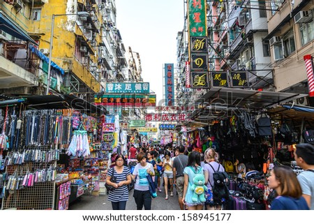 HONG KONG - MAY 24: Crowded market stalls in old district on March 24, 2013 in Hong Kong. With land mass of 1104 km and 7 million people, Hong Kong is one of most densely populated areas in the world. - stock photo