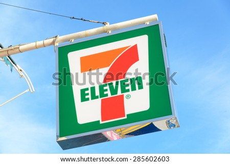 HONG KONG - MAY 9, 2015: 7-Eleven logo - 7-Eleven is the world's largest operator, franchiser, and licensor of convenience stores with more than 50,000 outlets. - stock photo
