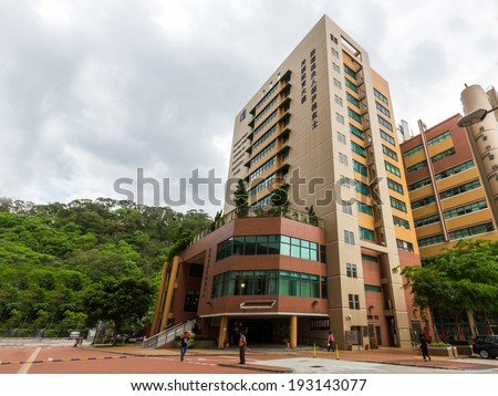 HONG KONG - MAY 15, 2014: School of continuing education tower in HKBU. Hong Kong Baptist University is a publicly funded tertiary institution with a Christian education heritage - stock photo