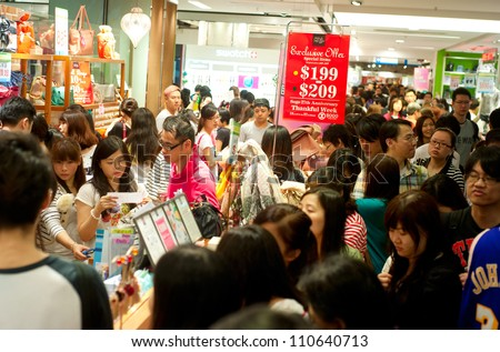 HONG KONG - MAY 19: Shopping mall on May 19, 2012 in Hong Kong. Shopping in Hong Kong is an important part of the culture. Basic items for sale do not draw any duties, sales tax or import tax. - stock photo
