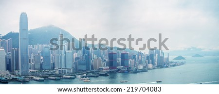HONG KONG - MAY 12, 2014: Stunning panoramic view of Hong Kong Island on a cloudy day. Last year HK hosted more than 54 million visitors, most of them from the mainland. - stock photo