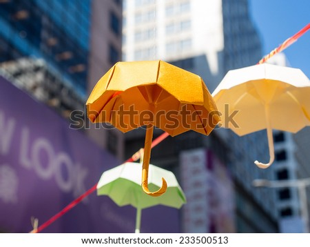 HONG KONG,NOV. 22:Many people in Hongkong are hang the yellow umbrellas paper.This is a symbol of revolution in occupy protest are fighting for truly free elections in Mong Kok  on 22 November 2014. - stock photo