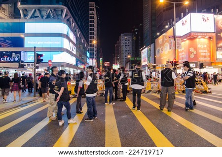 HONG KONG, OCT 16: Hongkong police beware a many protesters in Mong Kok on 16 October 2014. during Umbrella revolution, they will control protest do not make illegal. - stock photo