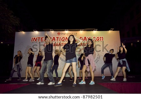 "HONG KONG - OCT 19: Lingnan University organises International Day on campus on October 19, 2011 in Hong Kong. There are some korean performing ""Korea Dance"" to showcase their culture. - stock photo"
