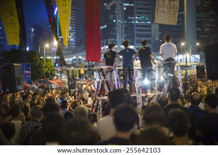 HONG KONG - OCT 15: The movement leaders are giving speech  in front of government headquarter during Umbrella Movement in Hong Kong on October 15 2014.   - stock photo