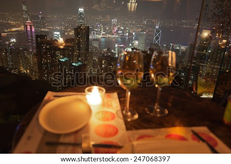 HONG KONG - OCTOBER 3, 2010: View from a restaurant on The Peak. Dining on Victoria Peak, with its spectacular views of the city and harbour, is a very special experience. - stock photo