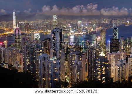 Hong Kong's skyline viewed from the Victoria Peak in the evening. - stock photo