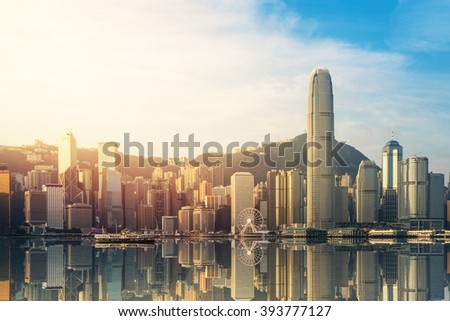 Hong Kong's Victoria Harbour in sunrise - stock photo