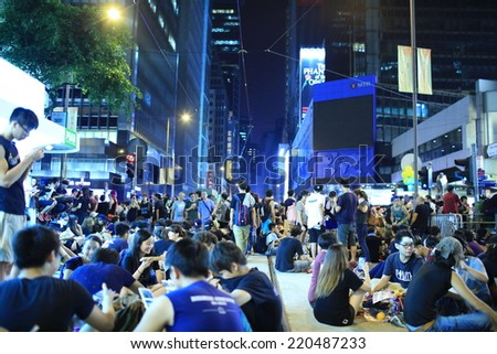HONG KONG, SEPT.29: Crowd of protesters occupy the road in Central business zone on 29 September 2014. after riot police fire tear shell to the peaceful protesters on 28 sept, people join the protest - stock photo
