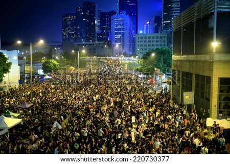 HONG KONG, SEPT.30: protesters occupy the street near government headquarter in Admiralty on 30 September 2014. after riot police fire tear shell to the peaceful protesters, people join the protest - stock photo