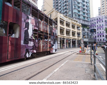 HONG KONG - SEPT 23: Unidentified people use city tram on September 23, 2011. Hong Kong tram is the only system in the world run with double deckers and one of the main tourist attractions. - stock photo