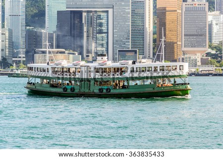 "HONG KONG - SEPTEMBER 20: Ferry ""Day Star"" arriving Kowloon pier on September 20, 2015 in Hong Kong, China. Hong Kong ferry is in operation for more than 120 years and is one main tourist attractions. - stock photo"