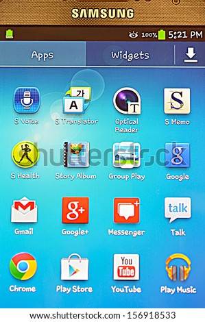 HONG KONG - SEPTEMBER 21 : Samsung S4 applications including Google+, Messenger, Talk, Group Play, Story Album, Play Store, Youtube, Play Music, Chrome, Gmail, runs Android 4.2 in September 21, 2013 - stock photo
